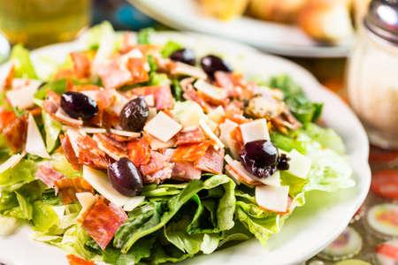 salad dressing: Freshly made Italian Chopped Salad in Italian restaurant. Stock Photo