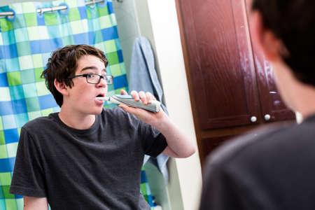 teen boy: Teenage boy getting ready for school in the morning. Stock Photo