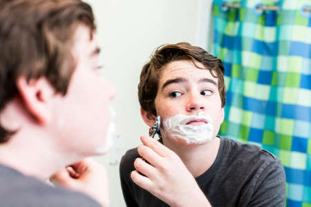 'getting ready': Teenage boy getting ready for school in the morning. Stock Photo