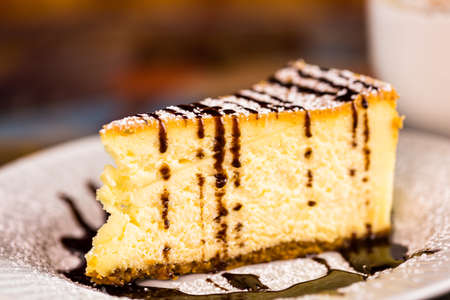energizing: Fresh Italian  cheesecake with coffee on the table.