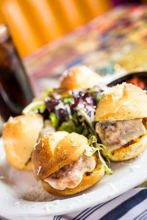 Fresh Italian meatball sliders on the table in Italian restaurant.
