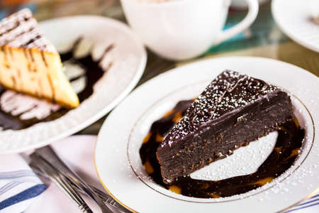 energizing: Fresh Italian Old Fashioned Chocolated cake with coffee on the table. Stock Photo