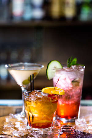 Colorful cocktails on the bar table in restaurant.
