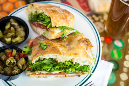 specialty: Fresh specialty sub sandwich with melted mozzarella cheese in Italian restaurant.