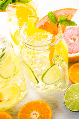 Infused water with fresh citrus fruits and ice. photo