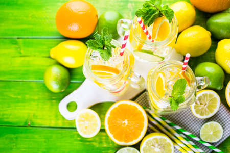 Infused water with fresh citrus fruits and ice. Stok Fotoğraf