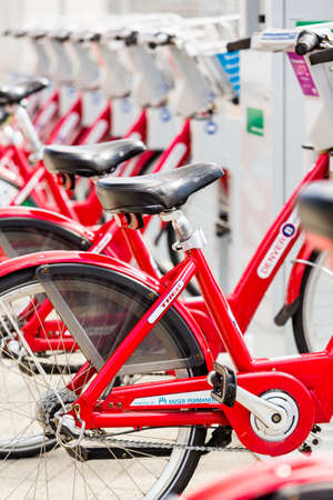 Denver, Colorado, USA-May 17, 2015. Row of red rental bikes at the Union Station in Denver, Colorado.