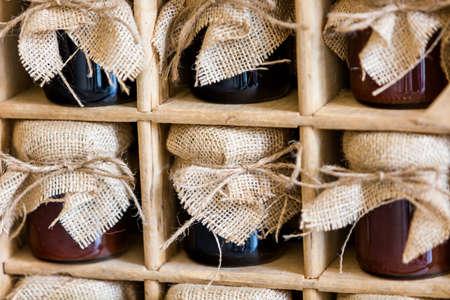 jams: Vintage jams with burlap top in wood box.