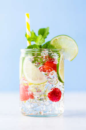 Fresh infused water made with organic ccitruses and berries. photo