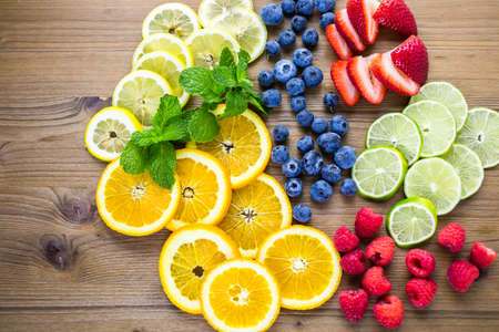 of fruit: Sliced fresh organic fruits prepared to make infused water. Stock Photo