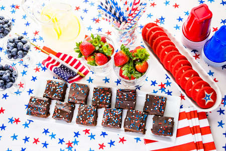 pastrie: Variety of desserts on the table for July 4th party. Stock Photo