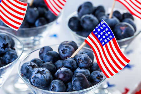 american food: Variety of desserts on the table for July 4th party. Stock Photo