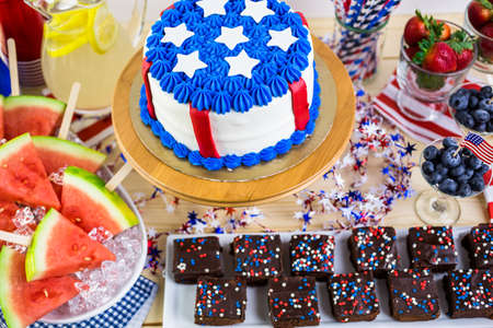 july 4th: Variety of desserts on the table for July 4th party. Stock Photo