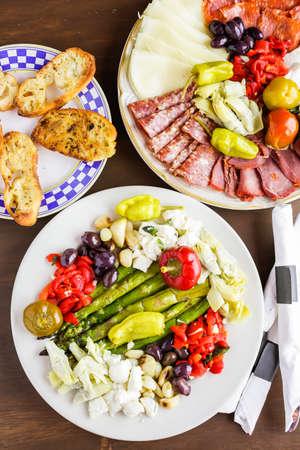 Appetizers plate with vegetarian antipasto in Italian restaurant.