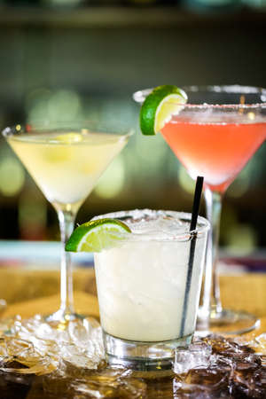 distilled alcohol: Variety of cocktails at the bar. Stock Photo