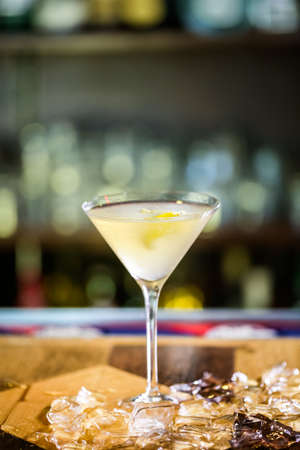 distilled: Limoncello martini cocktail prepared at the bar. Stock Photo