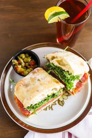 sub: Italian sub sandwich with arugula on ciabatta bread.