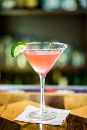 distilled alcohol: Cosmopolitan cocktail prepared at the bar. Stock Photo