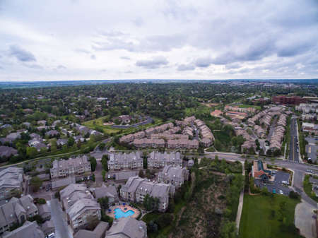 multifamily: Denver, Colorado, USA-June 5, 2015. Aerial view of aparment complex with outdoor swimming pool. Editorial