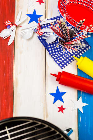Table set with white, blue and red decorations for July 4th barbecue. photo