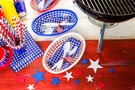 barbie: Table set with white, blue and red decorations for July 4th barbecue.