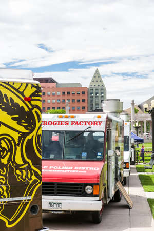 civic center: Denver, Colorado, USA-June 11, 2015.  Gathering of gourmet food trucks and carts in Downtown Denver Civic Center Park. Editorial