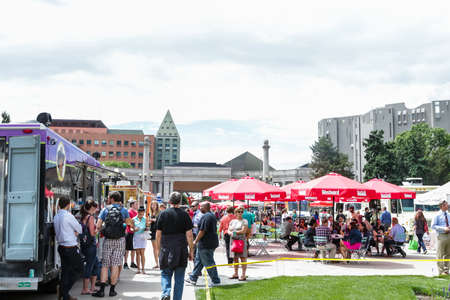 civic: Denver, Colorado, USA-June 11, 2015.  Gathering of gourmet food trucks and carts in Downtown Denver Civic Center Park. Editorial