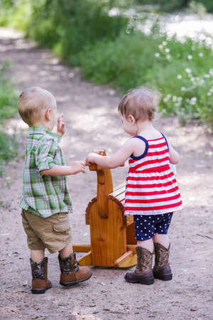 13 year old boy: Toddlers having fun in the park for July Fourth. Stock Photo