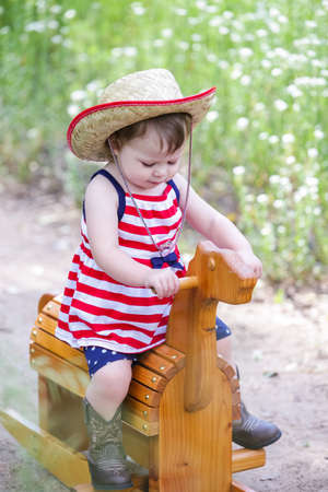 brim: Toddlers having fun in the park for July Fourth. Stock Photo