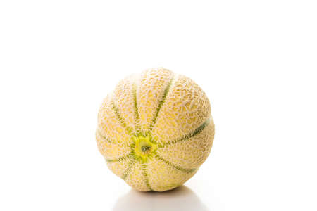 Whole organic musk melon on a white background.