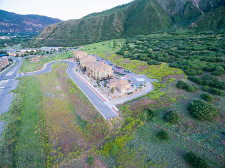multifamily: Glenwood Springs, Colorado, USA-June 20, 2015. Aerial view of apartment complex in the mountains.