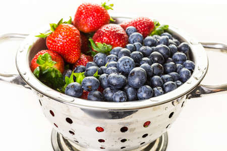 washed: Colander with washed organic berries.