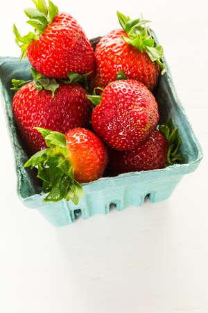 Fresh organic strawberries in berry basket.