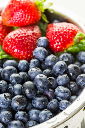 colander: Colander with washed organic berries.