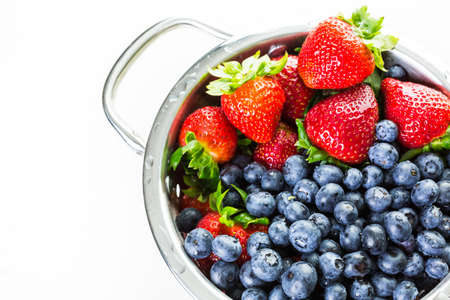 a colander: Colander with washed organic berries.