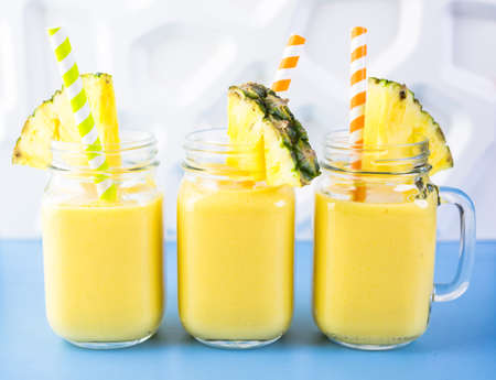 Homemade mango and pineapple smoothie made with coonut milk.