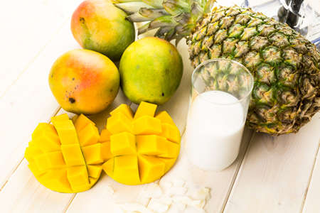 tropical fruits: Fresh ingredients on the table to make smoothie with tropical fruits.