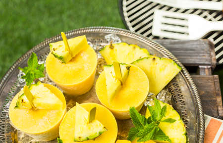 low  calorie: Homemade low calorie popsicles made with mando, pineapple and cocconut milk at the summe rpicnic. Stock Photo