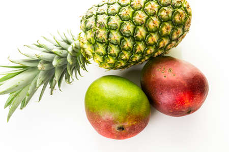 Organic tropical fruits on a white background.