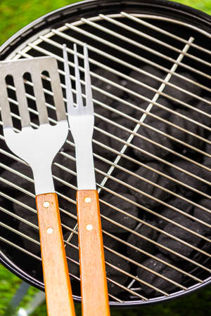 charcoal grill: Small round charcoal grill ready for grilling at the summer picnic.