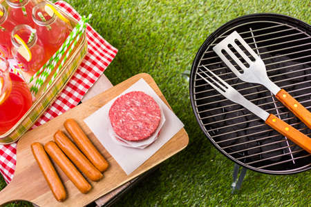 charcoal grill: Summer picnic with small charcoal grill in the park.