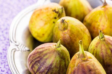 Organic California figs on wood table.