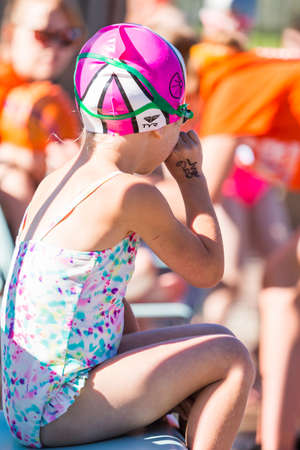 minors: Denver, Colorado, USA-July 11, 2015. Kids swim meet in outdoor pool during the summer.