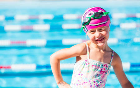 Denver, Colorado, USA-July 11, 2015. Kids swim meet in outdoor pool during the summer.