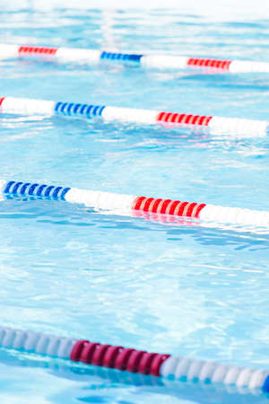minors: Kids swim meet in outdoor pool during the summer.