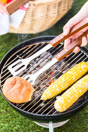 barbie: Small summer picnic with lemonade and hamburgers in the park. Stock Photo