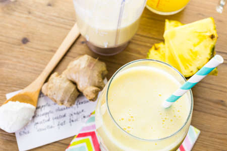 Freshly made pineapple ginger smoothie with Greek yogurt and juice.