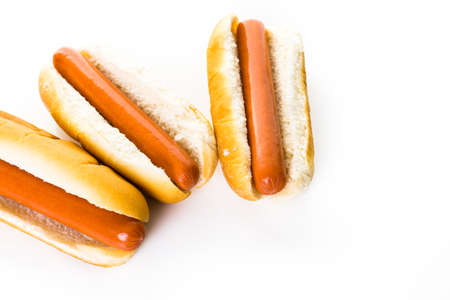 Traditional hot dogs on a white hot dog bun on a white background. Stock Photo