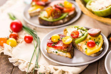 Tomato sandwich made with organic heirloom tomatoes. Stock Photo