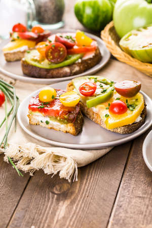 heirloom: Tomato sandwich made with organic heirloom tomatoes. Stock Photo